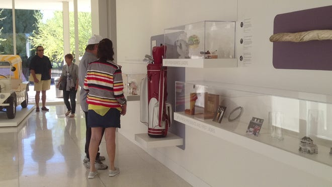 """Visitors look at a display of gifts collected by Walter and Leonore Annenberg. The exhibit, """"Sunnylands: Selections from the Gift Collection of Walter & Leonore Annenberg,"""" opened Sunday at the Sunnylands Center & Gardens in Rancho Mirage."""