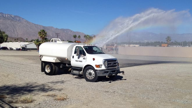 A water truck prepares an area that will be used for Cathedral City's Hot Air Ballon Festival Saturday.