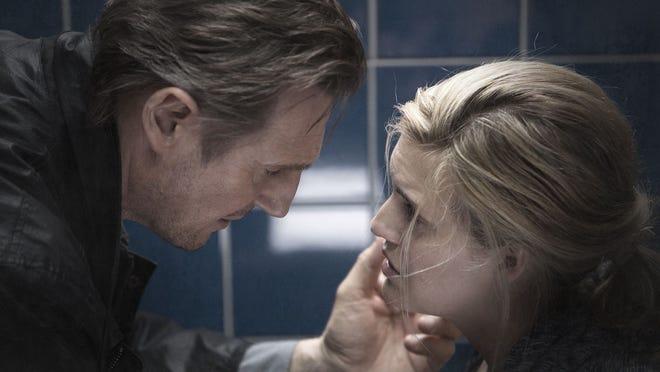 """Liam Neeson talks to Maggie Grace in a scene from """"Taken 3."""""""