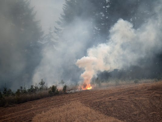 A combine sparks blaze outside Monroe, structures threatened