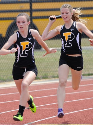 Padua's Darby Deutsch left receives the baton from teammate Cameron Lucey in the 4x100 meter relay at the state track meet at Dover High School.