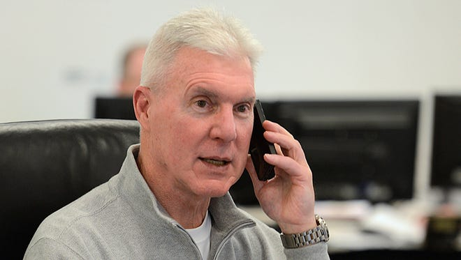 Green Bay Packers general manager Ted Thompson talks on the phone inside the war room during the NFL Draft at Lambeau Field in Green Bay on Thursday, May 8, 2014. Evan Siegle/Press-Gazette Media