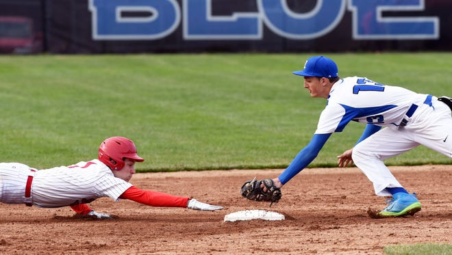 Zanesville second baseman Brandon Pritchard makes a tag on Lakewood's Cameron Downs during the fifth inning of the Blue Devils' 2-0 loss on Tuesday at Jay Payton Field.