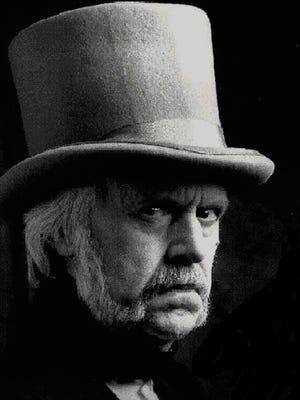 Stu Smith as Ebenezer Scrooge