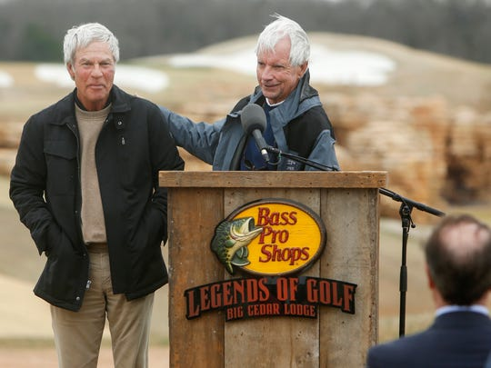 Bill Coore, right, pats his business partner Ben Crenshaw