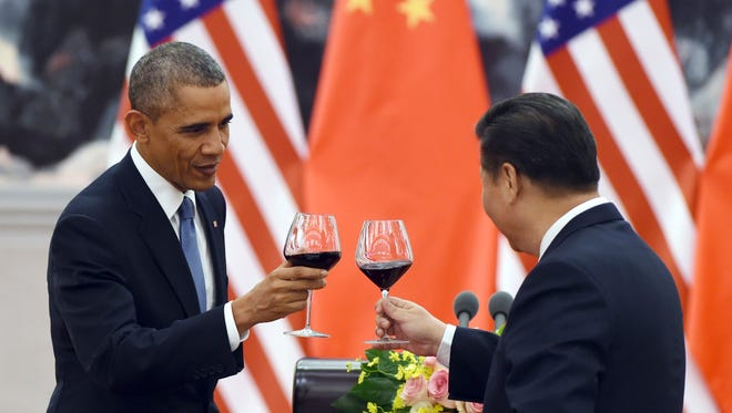 President Obama toasts with Chinese President Xi Jinping, at a lunch banquet in the Great Hall of the People in Beijing last November.