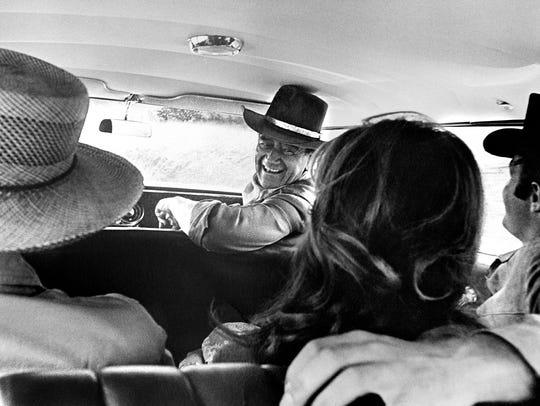 "John Wayne on the set of ""El Dorado"" with Howard Hawks,"