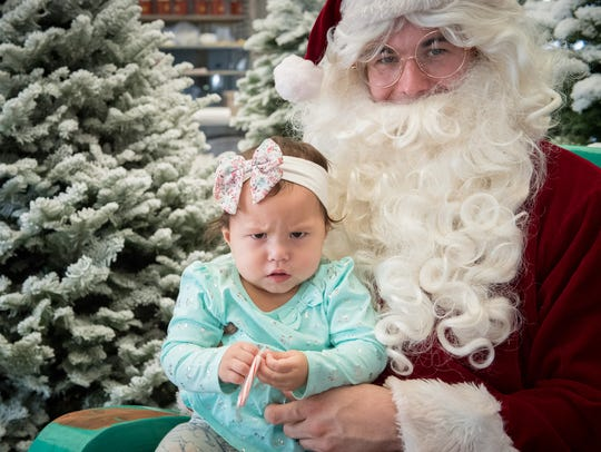 Rosalia is skeptical of Santa (Staff Sgt. Michael Pace,