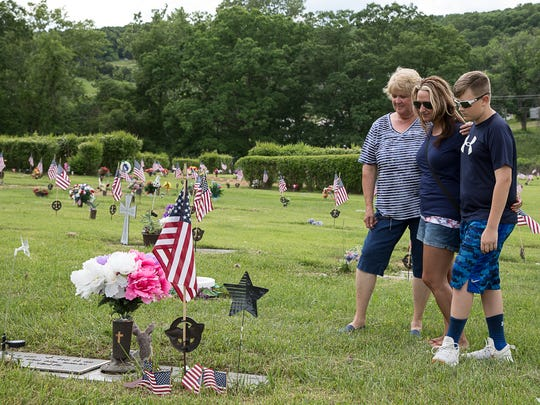 (L-R) Mary Ann, Jamie, and Drew Arledge visit the grave