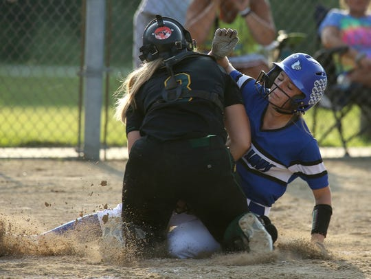 Des Moines Hoover junior catcher Hannah Poortinga tags