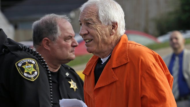 FILE - In this Aug. 12, 2016, file photo, former Penn State University assistant football coach Jerry Sandusky, right, arrives at the Centre County Courthouse in Bellefonte, Pa. Penn State University has filed paperwork indicating it intends to sue the charity founded by ex-assistant football coach Jerry Sandusky, whose child molestation scandal rocked the school in 2011. (AP Photo/Gene J. Puskar, File)