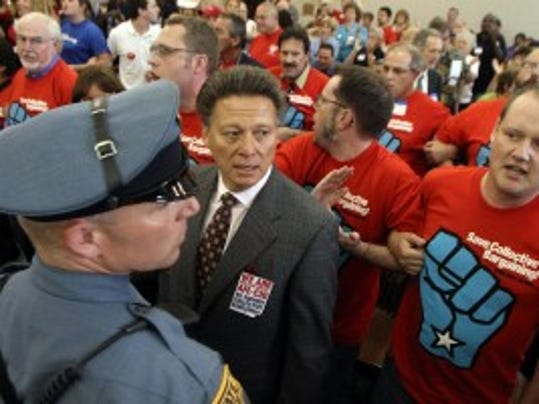 Charles Wowkanech, AFL-CIO state president, watches as union members are escorted from a hearing on pension and benefit reform on June 16, 2011.