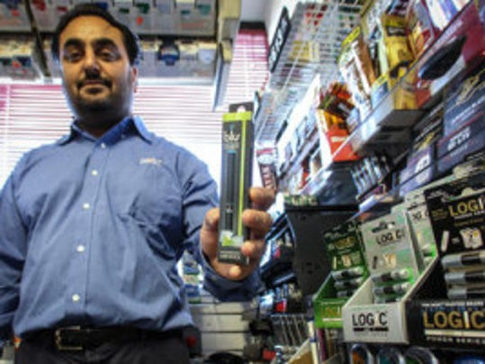 APP file photo: Daler Brar shows off an e-cigarette at the Mobil station convenience store in Neptune City.