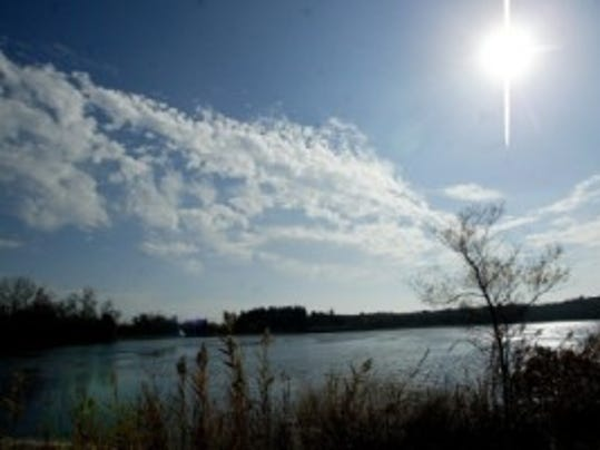 Sun and clouds fill the sky on a mild day over Cedar Lake in Lacey. (File photo)