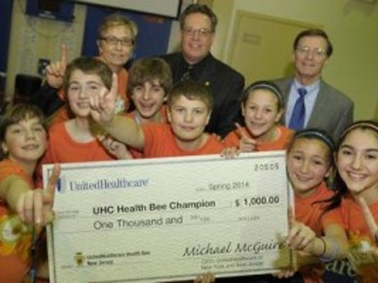 NJ Press Media file photo: Consumers celebrate with a check from UnitedHealthcare.  (Not quite the same thing).