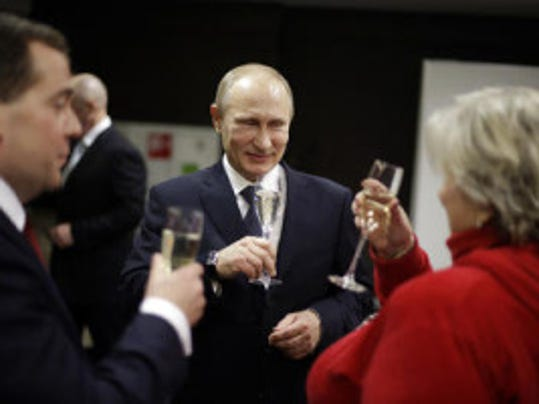 AP file photo of Putin during happier times. (That product likely was not made in New Jersey).