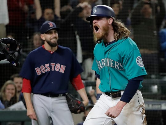 Mariners outfielder Ben Gamel celebrates after he scoring