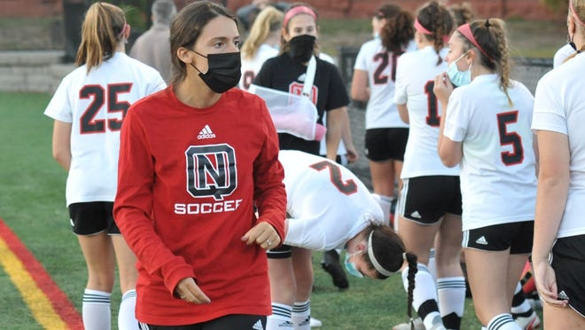 North Quincy Red Raiders new girls soccer head coach Devon McKay readies her team for their match with Quincy at Veterans Stadium in Quincy, Wednesday, Oct. 14, 2020.