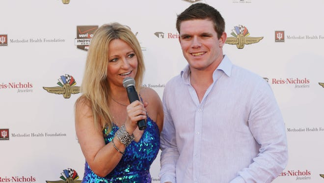 Laura Steele interviews IndyCar driver Conor Daly during red-carpet festivities for the May 2 Rev party at Indianapolis Motor Speedway.