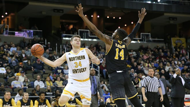 Northern Kentucky Norse forward Drew McDonald (34) passes around Milwaukee Panthers forward Vance Johnson (14) in the first half during the NCAA basketball game between the Milwaukee Panthers and the Northern Kentucky Norse, Thursday, Feb. 8, 2018, at BB&T Arena in Highland Heights, Ky.