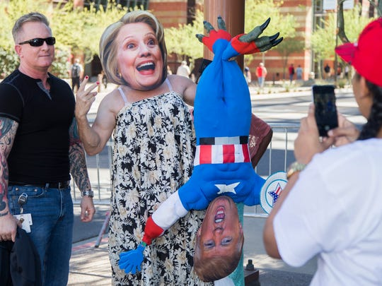 AJ Addison (left) poses with Jorge Mendez dressed as Hillary Clinton before a Donald Trump rally at the Phoenix Convention Center on Oct. 29, 2016 in downtown Phoenix. Hundreds lined up outside the convention center.