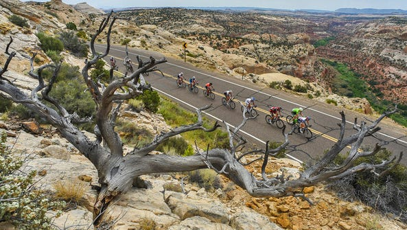 In this Aug. 2, 2016, file photo, cyclists race along