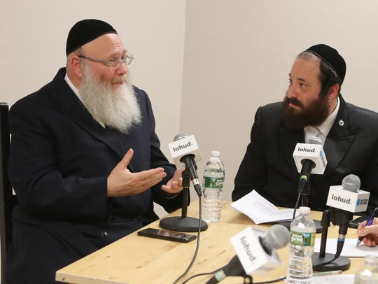 Yosef Rapaport, a media consultant from Brooklyn, left,