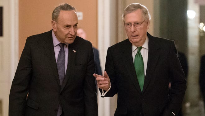 Senate Minority Leader Chuck Schumer, D-N.Y., left, and Senate Majority Leader Mitch McConnell, R-Ky., walk to the chamber after collaborating on an agreement in the Senate on a two-year, almost $400 billion budget deal that would provide Pentagon and domestic programs with huge spending increases, at the Capitol in Washington Wednesday. It passed early Friday.