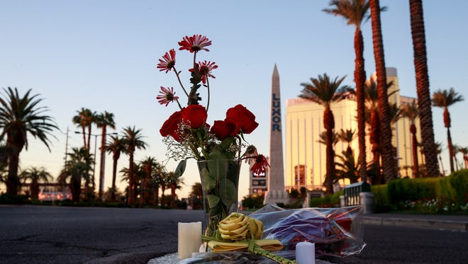 LAS VEGAS, NV - OCTOBER 3: Flowers were left on Las Vegas Blvd. near the scene of Sunday night's mass shooting, October 3, 2017 in Las Vegas, Nevada. The gunman, identified as Stephen Paddock, 64, of Mesquite, Nevada, allegedly opened fire from a room on the 32nd floor of the Mandalay Bay Resort and Casino on the music festival, leaving at least 58 people dead and over 500 injured. According to reports, Paddock killed himself at the scene. The massacre is one of the deadliest mass shooting events in U.S. history. (Photo by Drew Angerer/Getty Images)