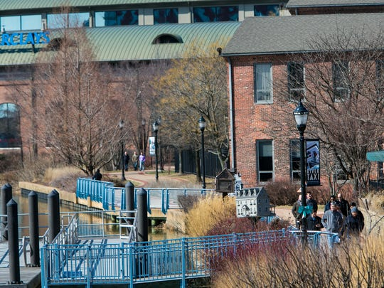 Walkers enjoy the Wilmington Riverfront on Monday.