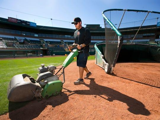 Scottsdale Stadium grounds crew worker Joseph Lago