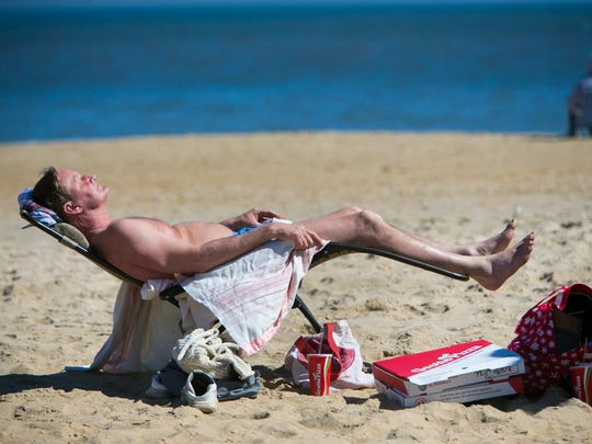 Patrick Goldbach of Lancaster, Pa., picked the perfect day to take off work as he kicks back and basks in the warm sun of Rehoboth Beach on Wednesday, March 9, 2016.