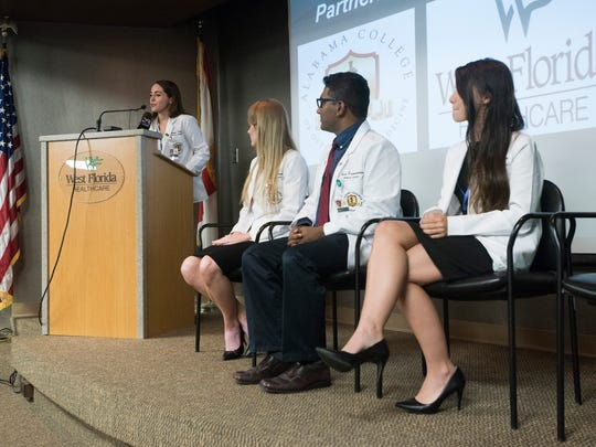 At left, Jennifer Fields, an Alabama College of Osteopathic Medicine medical student, addresses the media during a press conference Tuesday, July 25, 2017, at West Florida Healthcare.