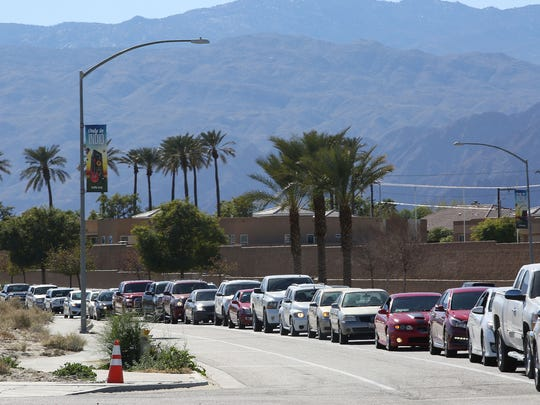 Cars were lined up for the Arco AM PM gas station on Jefferson St. in Indio after they dropped the price of regular unleaded gas to $1.99 for four hours Monday afternoon, January 21, 2018.