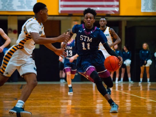 St. Thomas More's Jonathan Cisse and the Cougars are the No. 1 seed in the Division II boys basketball playoff bracket.