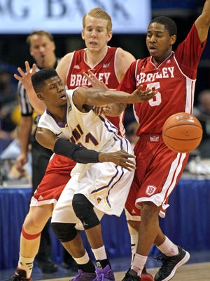Northern Iowa's Wes Washpun (11) passes out of the defensive trap of Bradley's Anthony Fields (3) and Nate Wells (52)  in the first half of an NCAA college basketball game in the quarterfinals of the Missouri Valley Conference Tournament on Friday, March 6, 2015, in St. Louis.