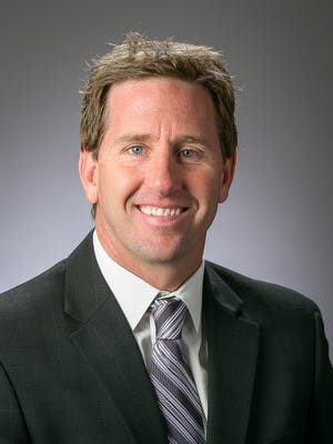 After coaching at Westminster, Weber State and the University of Utah, JD Gustin is now the head women's basketball coach at Dixie State University.