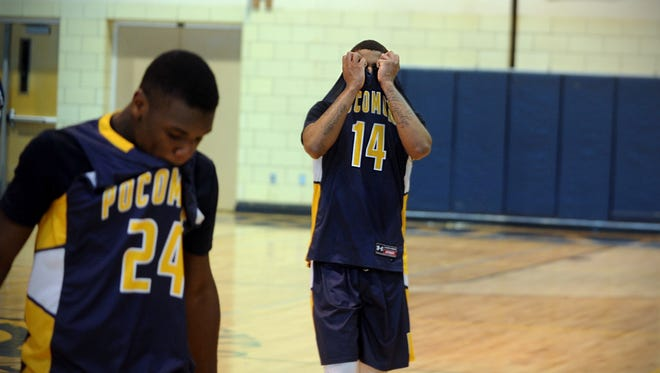 Tyree Thornton (24) and Tyrone Matthews (14) walk off the court after the Warriors' loss in the 1A East Region Final on Saturday, March 4, 2017 in Worton.