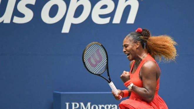 Serena Williams reacts after winning a point against Tsvetana Pironkova in U.S. Open women's singles quarterfinal in New York.