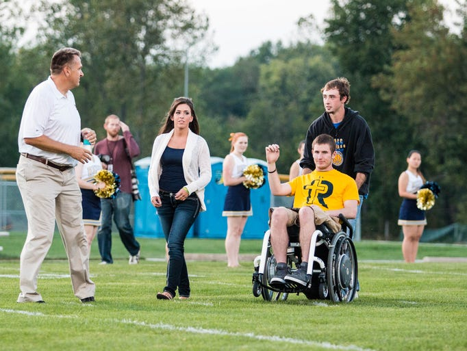 Chris Norton was recognized as an honorary assistant coach for Iowa City Regina as the Regals stormed to a 45-0 lead at half at Regina in Iowa City on Friday September 27, 2013. Regina moved to 5-0 on the season with the 51-0 win on their homecoming.
