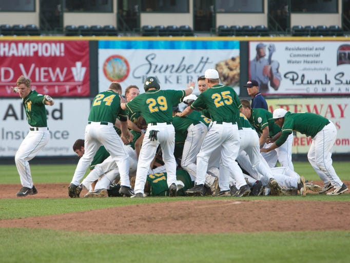 Iowa City West High School's celebrates a come-from-behind win over Johnston Friday, Aug. 1, 2014, during the 2014 IHSAA Class 4A State Baseball Tournament at Principal Park in Des Moines.