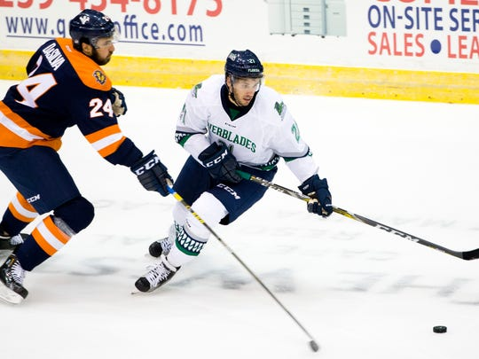 The Everblades' Brendan O'Donnell, right, is guarded by Greenville's Justin DaSilva (24) in the first period of action at Germain Arena Friday, October 14, 2016 in Estero.