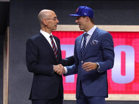 Luke Kennard walks on stage with NBA commissioner Adam Silver after being drafted 12th overall by the Detroit Pistons during the first round of the 2017 NBA Draft at Barclays Center on June 22, 2017 in New York City.