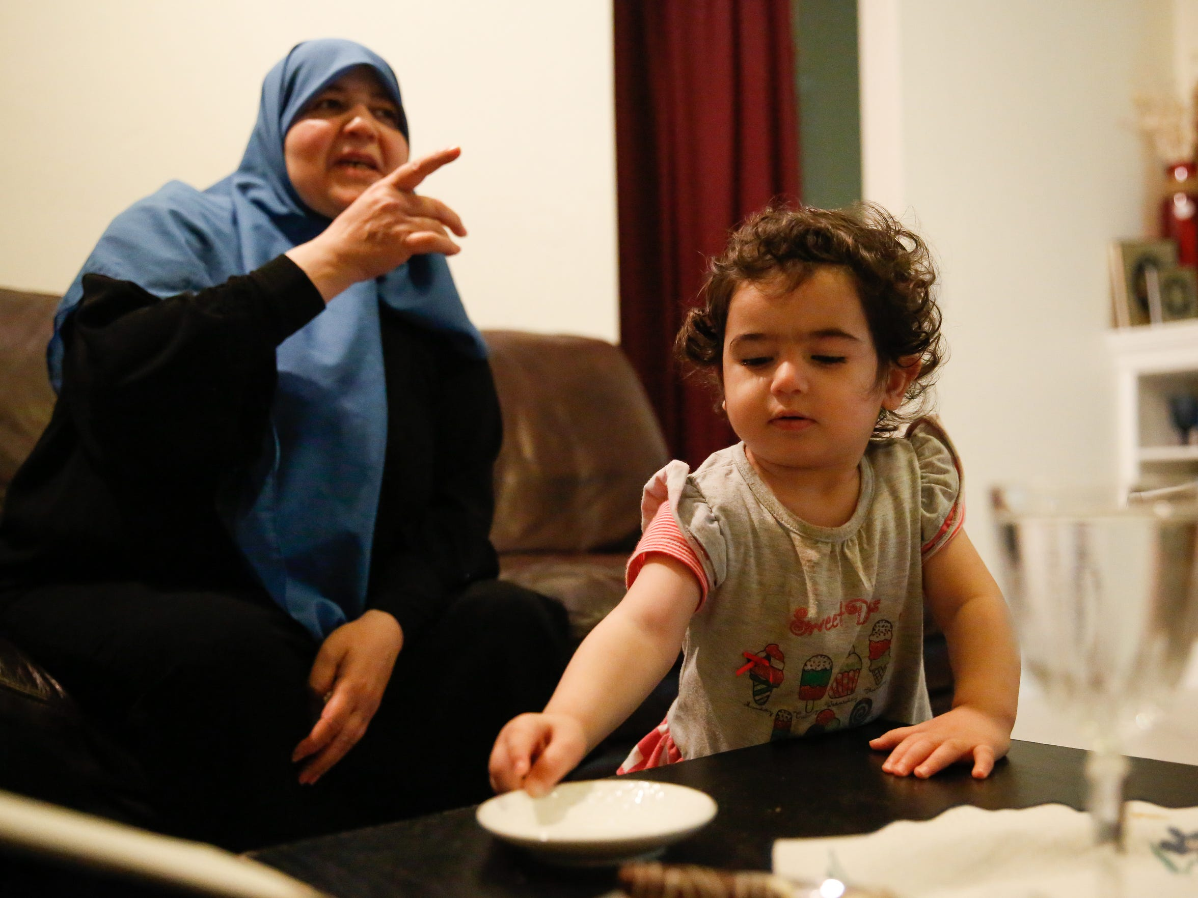 Osaima Alhalabi spends time with her granddaughter who is named after her.