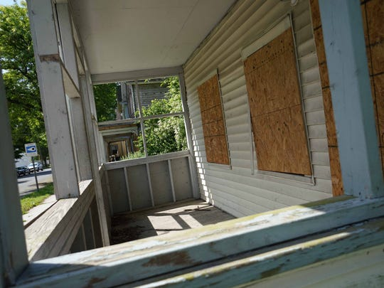 Properties along N. Kirkwood St. wait for demolition and will be rebuilt by Strong Neighborhood Housing Funds near downtown Dover in an effort to stop blight and improve housing.