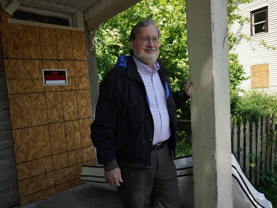 Joe Myer, executive director of NCALL, stands at home on N. Kirkwood St. that is scheduled for demolition and will be rebuilt by Strong Neighborhood Housing Funds near downtown Dover in an effort to stop blight and improve housing.