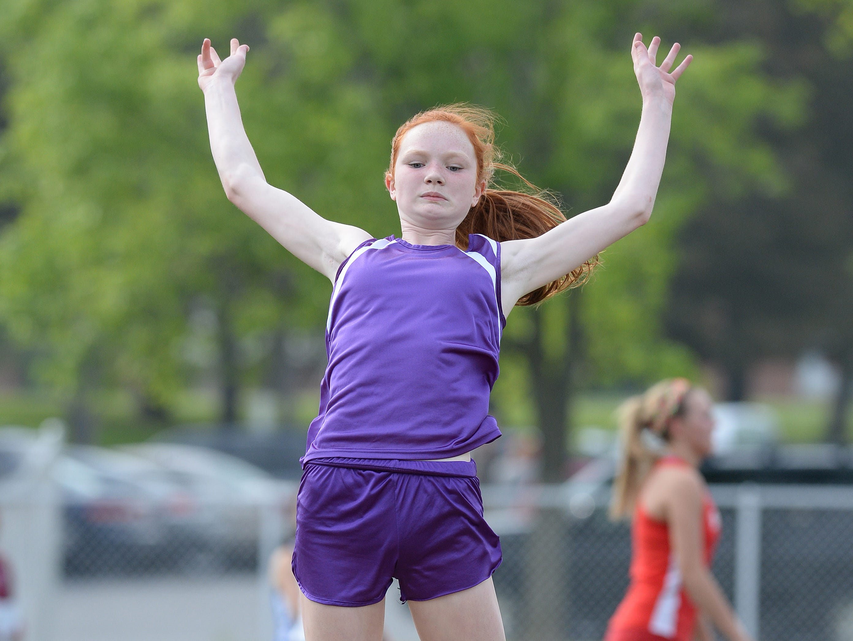 Hagerstown's Aimee Hoodlebrink competes in long jump during the track and field sectional at Connersvile this past May.