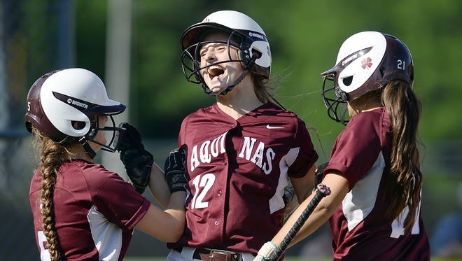 Aquinas' Erin Flaherty, center, celebrates her run with teammates Emily Monachino, left, and Sam Ashman during the Section V Class A2 Championship played at SUNY Brockport on May 28, 2015.