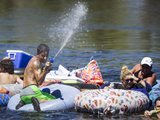 Rafters ride inner tubes on the Lower Salt River in Mesa on Sunday, Sept. 4, 2016.