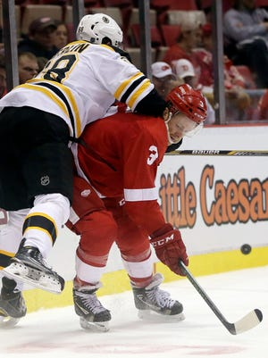 Detroit Red Wings defenseman Nick Jensen (3) takes out Boston Bruins right wing Brian Ferlin on Sept. 30, 2016, in Detroit.